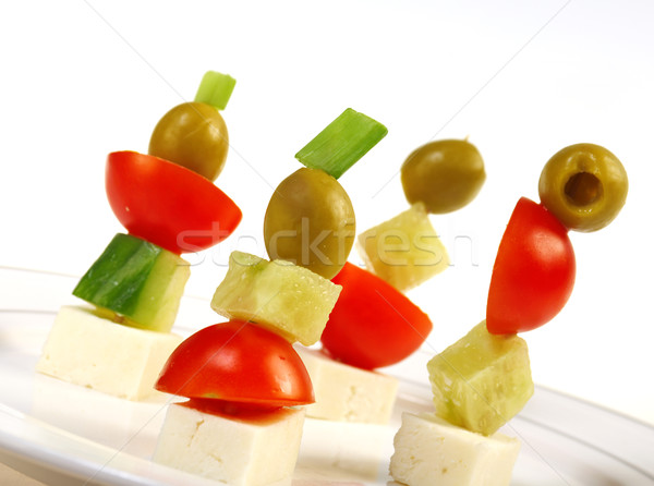 Canape platter with cheese cucumber tomato olives stock for Canape platters
