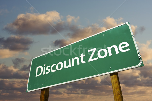 Stock photo: Discount Zone Green Road Sign and Clouds