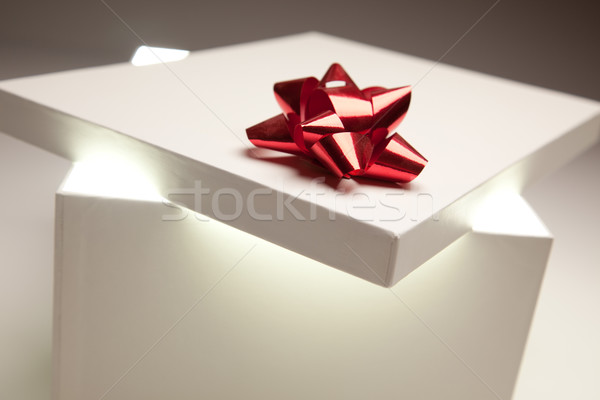 Stock photo: Red Bow Gift Box Lid Showing Very Bright Contents