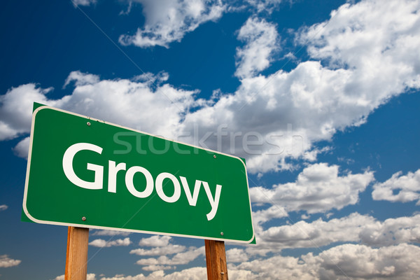 Stock photo: Groovy Green Road Sign with Sky