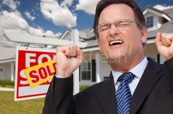 Stock photo: Excited Man in Front of Sold Real Estate Sign and House