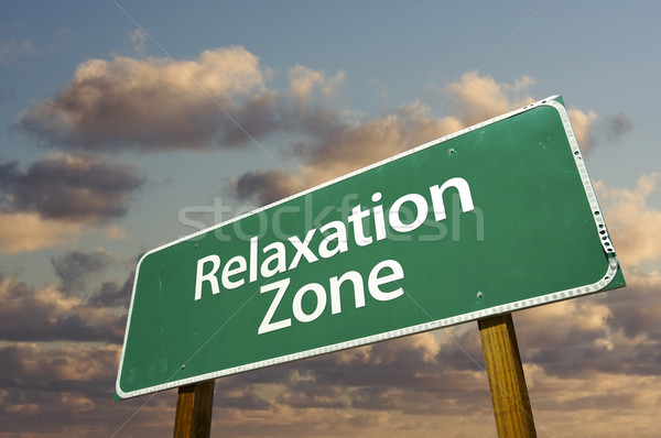 Stock photo: Relaxation Zone Green Road Sign and Clouds