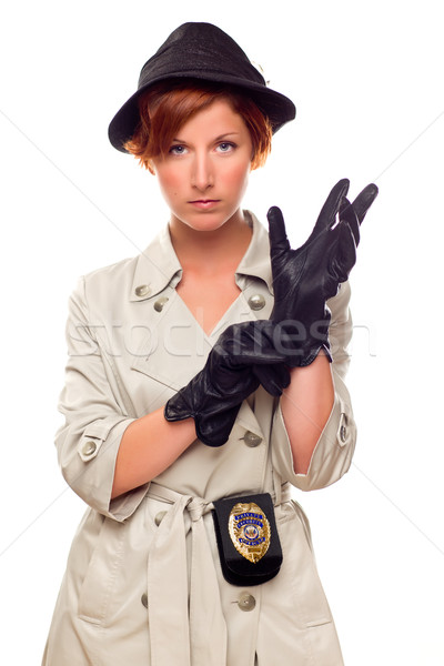 Stock photo: Red Haired Female Detective Putting on Gloves Wearing a Trenchco