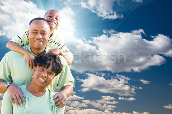 Stock photo: Happy African American Family Over Blue Sky and Clouds