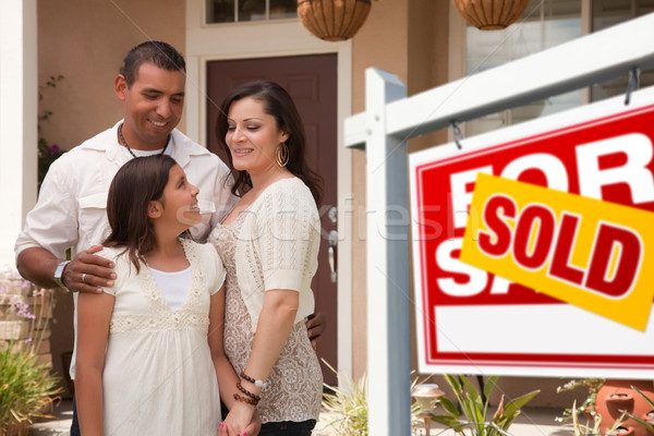 Stock photo: Hispanic Family in Front of Their New Home with Sold Sign