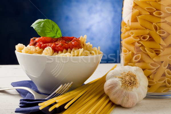 Stock photo: Pasta with tomato sauce on blue background