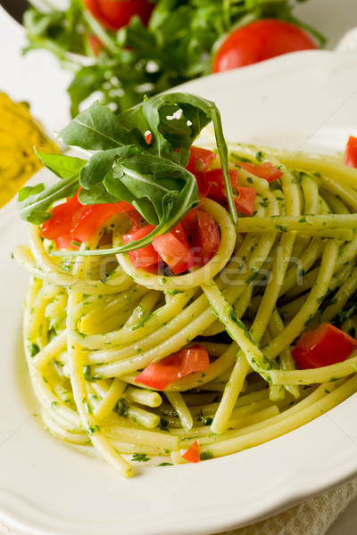 Stock photo: Pasta with arugula pesto and cherry tomatoes