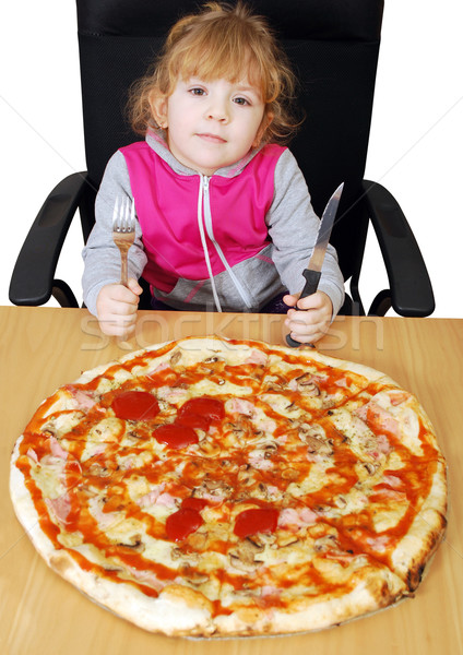 Stock photo: little girl with pizza