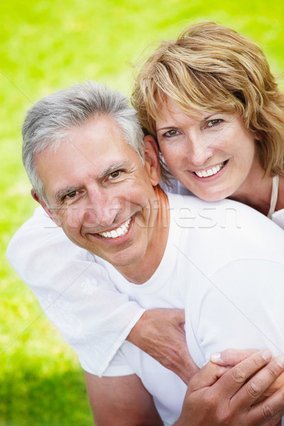 Stock photo: Mature couple smiling and embracing