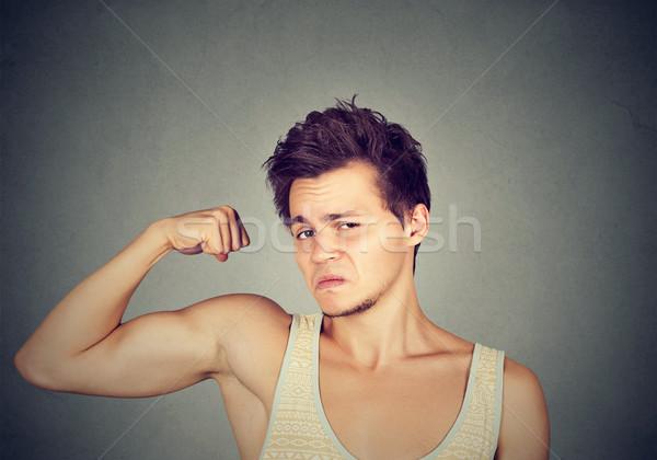 Funny sport man flexing his biceps