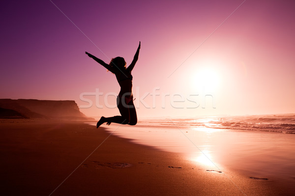 Stock photo: Jumping on the beach