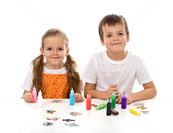 Stock photo: Kids coloring with lots of small painting bottles