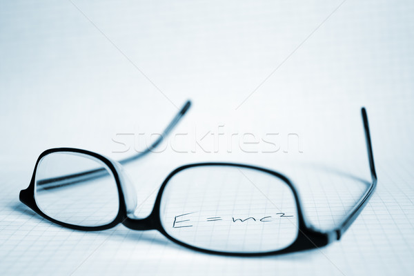 Stock photo: Glasses and paper with Albert Einstein's E=mc2