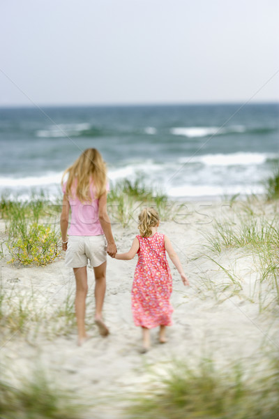 Stock photo: Sisters walking on beach.