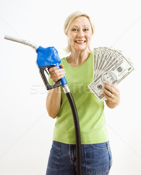 Stock photo: Happy woman with gas pump and money.