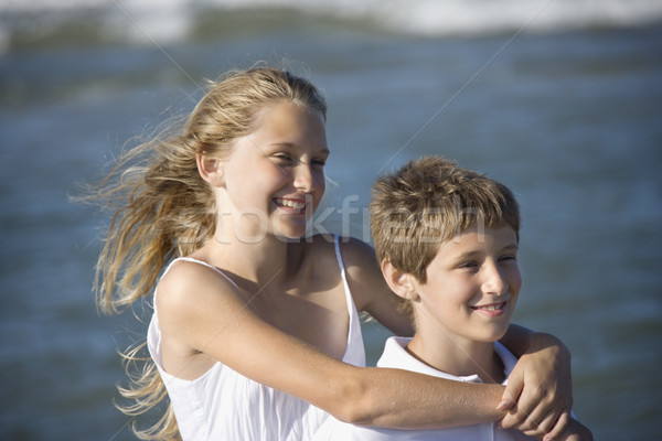 brother and sister hugging teens
