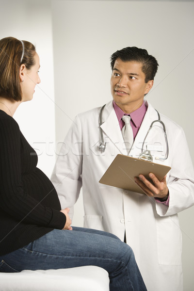 Stock photo: Doctor examining pregnant woman.