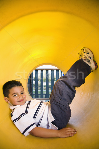 Stock photo: Young Boy Lying in Crawl Tube