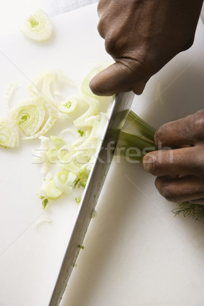 Stock photo: Knife chopping fennel.