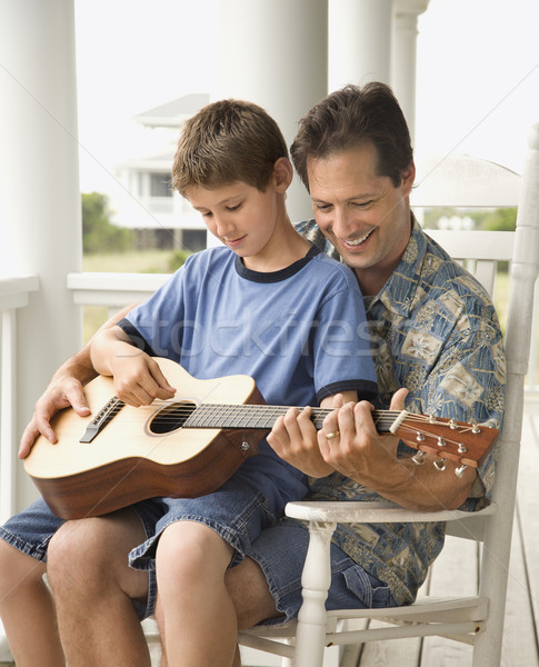 Stock photo: Father and Son Playing Guitar