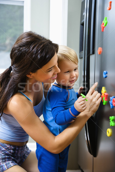Stock photo: Mom with child.