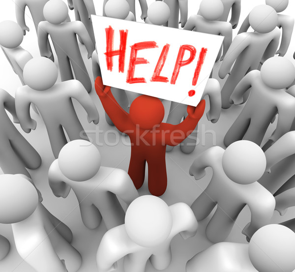 Person Holding Help Sign in Crowd stock photo © iqoncept (#327459 ...
