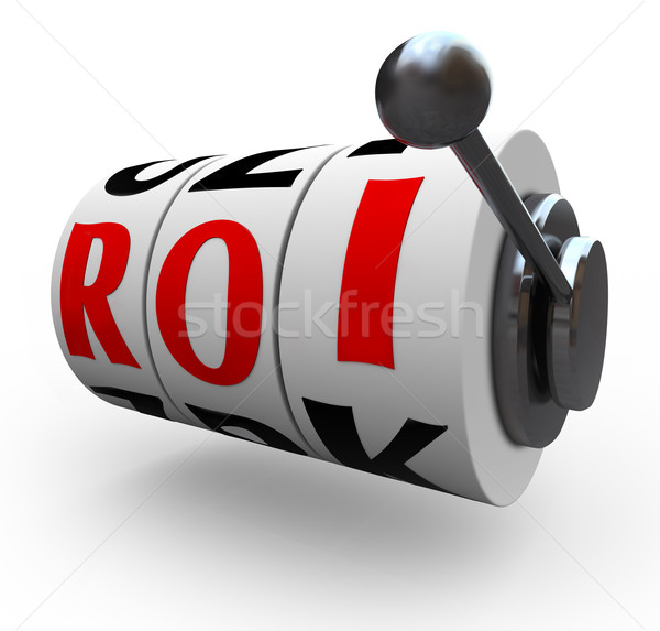 Stock photo: ROI Return on Investment Slot Machine Wheels