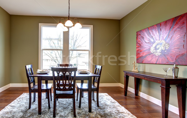 Dining Room With Green Walls And Red Painting. Stock Photo