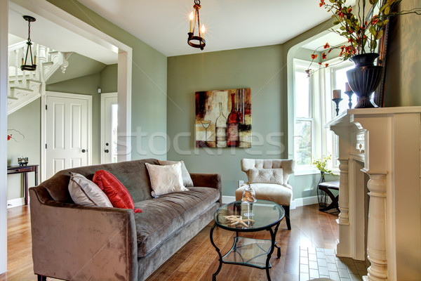 Living Room Sofa on Elegant Green Living Room With Brown Sofa And Wood Floor  Stock Photo