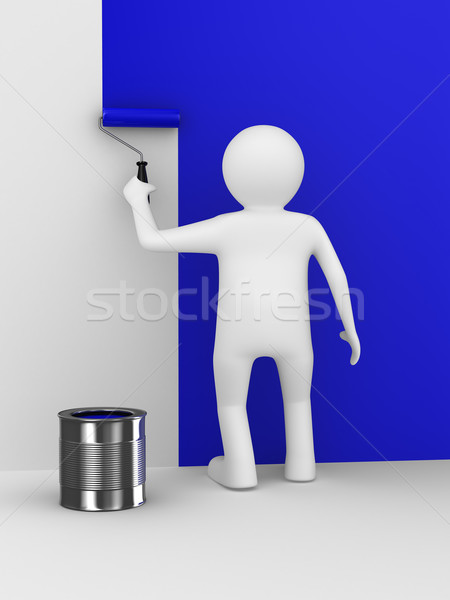 Stock photo: Man paints a wall with roller brush
