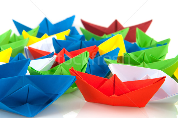 Paper boats in different colors