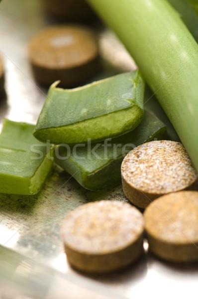 aloe vera plant with pills - herbal medicine