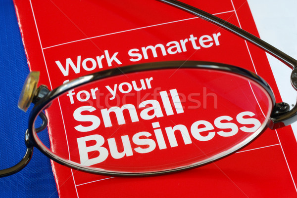 Stock photo: Focus on banking with Small Business isolated on blue