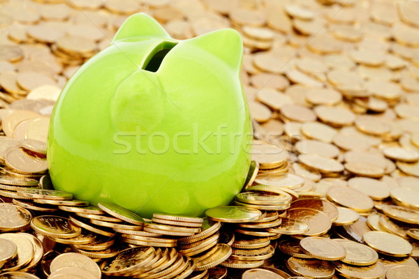 Stock photo: Green piggy bank and sea of  gold money