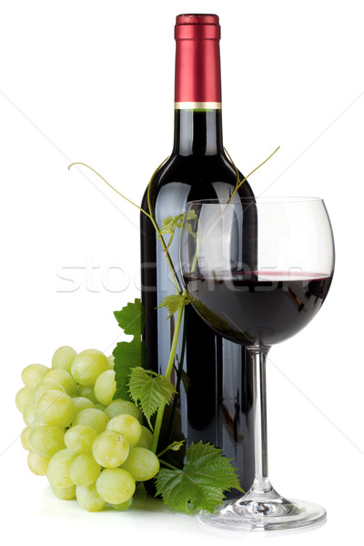 Stock photo: Red wine glass, bottle and grapes