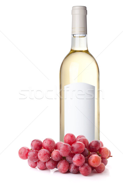 Stock photo: White wine in bottle and red grapes
