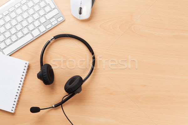 Stock photo: Office desk with headset. Call center support