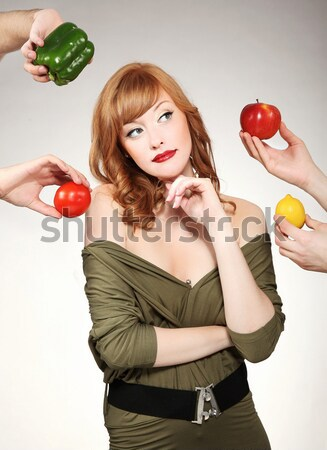 Stock photo: Beautiful woman making a fruit choice