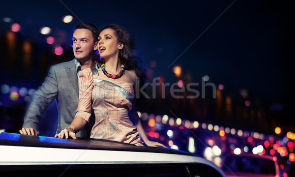 Stock photo: Elegant couple traveling a limousine at night