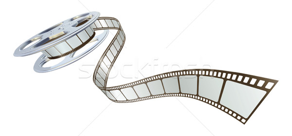 Stock photo: Movie film spooling out of film reel