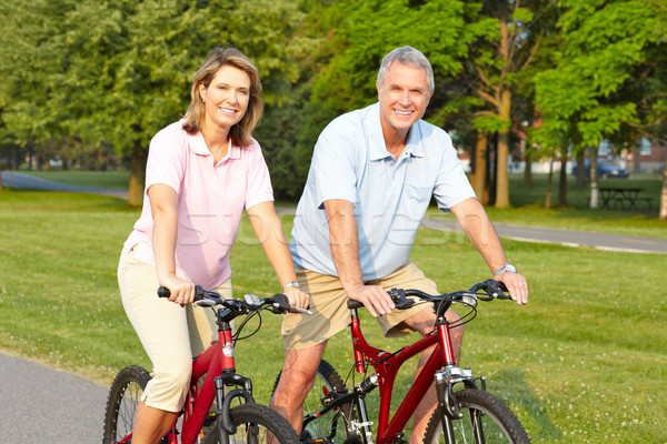 Stock photo: seniors couple biking