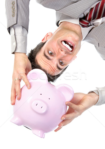 Stock photo: Businessman with a piggy bank