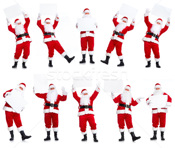 Stock photo: Group of Christmas Santa Claus with poster.