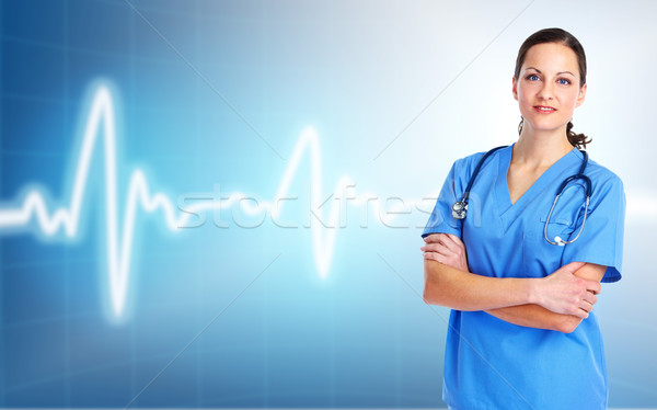 Stock photo: Medical doctor woman. Over cardio background.