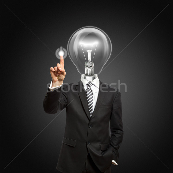Stock photo: businessman with lamp-head push the button
