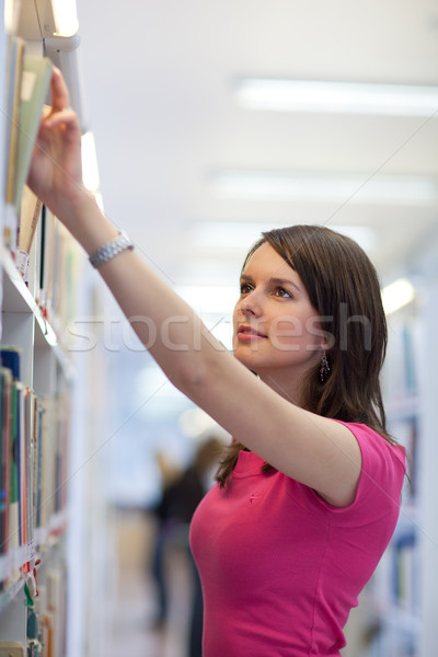 Stock photo: pretty young college student in an university library (shallow D