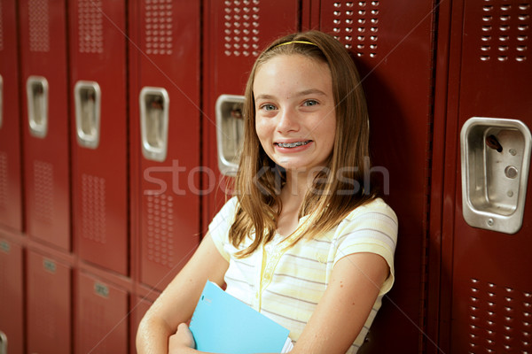 Cute Teen Girl by Lockers stock photo © Lisa Young (lisafx ...