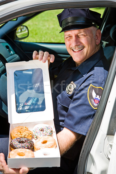 Stock photo: Police Officer - Box of Donuts
