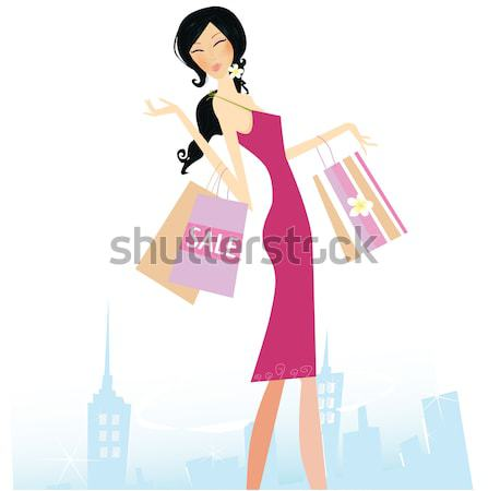 Stock photo: Shopper girl in pink dresscarrying shopping bags