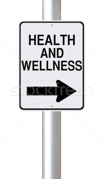 A modified one way street sign on Health and Wellness